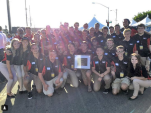 The Badgerloop team, shown in August 2017 with an award